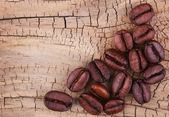 Coffee Beans on Old Wooden Background. — Stock Photo
