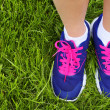 Sport Footwear on Female Feet on Green Grass. Closeup Running Sh — Stock Photo #46189441