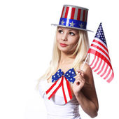 Patriotic Woman with American Flag isolated on white — Stock Photo