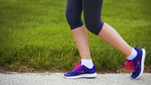 Runner Female Feet Running beside Green Grass. Jog — Stock Photo