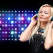 Young DJ Woman with Headphones. Happy Blonde Girl Enjoying the M — Stock Photo #48971491