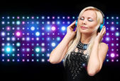 Young DJ Woman with Headphones. Happy Blonde Girl Enjoying the M — Stock Photo