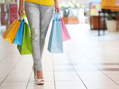 Shopping. Woman with Colorful Shopping Bags in Shopping Mall — Stock Photo
