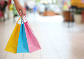 Shopping! Female Hand Holding Colorful Shopping Bags in Shopping — Stock Photo