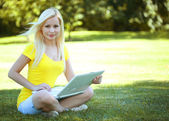 Girl with laptop. Blonde beautiful young woman with notebook — Stock Photo