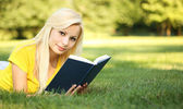 Blonde Girl with Book on Green Grass. Beautiful Woman Outdoor — Stock Photo
