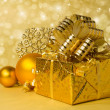 Royalty-Free Stock Photo: Golden gift box and Christmas balls