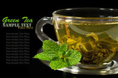 Green tea in a glass cup — Stock Photo