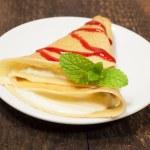 Pancake with cream cheese and strawberry jam — Stock Photo #18523773