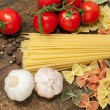 Spaghetti, farfalle , cherry tomatoes and garlic — Stock Photo