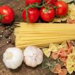 Spaghetti, farfalle , cherry tomatoes and garlic — Stock Photo