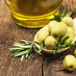 Stock Photo: Olives with rosemary and olive oil
