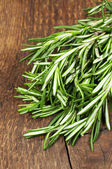 Rosemary on a wooden background — Stock Photo