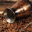 Copper Turk and coffee beans — Stock Photo