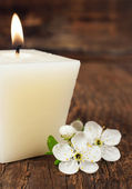 Aromatic candle with cherry blossom — Stock Photo