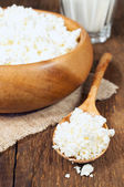 Cottage cheese in a wooden bowl — Stok fotoğraf