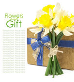 Bouquet of daffodils and gift box — Stock Photo