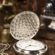 Royalty-Free Stock Photo: Still life with vintage pocket watch close-up