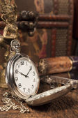 Still life with pocket watch — Stock Photo
