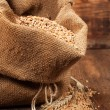 Wheat in burlap bag - Stock Photo