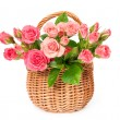 Stock Photo: Pink roses in wicker basket