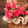 Stock Photo: Roses in a wicker basket