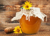 Sweet honey on a wooden background — Stock Photo