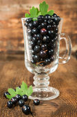 Ripe black currants in glass — Stock Photo
