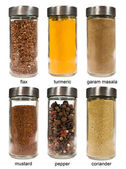 Set of spices in glass jars — Stock Photo