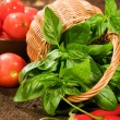 Fresh basil in basket with vegetables — Stock Photo #29237083