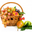 Assortment of fruits in a basket — Stock Photo
