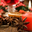 Christmas background : candle and spices — Stock Photo