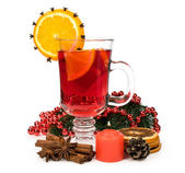 Mulled wine with spices and a candle — Stock Photo