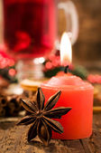 Red Candle and Christmas spices close-up — Stock Photo