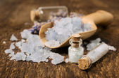 Sea salt with lavender in wooden scoop — Stock Photo