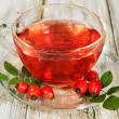 Rosehip drink with fresh berries — Stock Photo