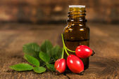 Bottle of essential oil of rose hips — Stock Photo