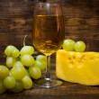 Still life with white wine , cheese and grapes — Stock Photo