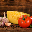Cheese, tomatoes , garlic and spices — Stock Photo