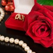 Wedding background .Rose , pearls and a gold ring — Stock Photo