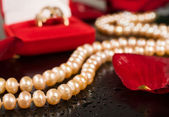 Luxury. pearl necklace on a black background — Stock Photo
