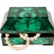 Malachite  treasure-box with a pearl necklace — Stock Photo