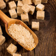 Brown cane sugar cubes and granules — Stock Photo