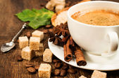 Coffee with cinnamon, star anise , coffee beans and cane sugar — Stock Photo