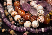 Beads of different stones close-up — Stock Photo