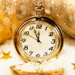 Stock Photo: Pocket watch showing five minutes to midnight.
