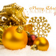 Golden Christmas balls and gift box in the snow — Stock Photo