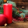 Christmas still life with candle and decorations — Stock Photo