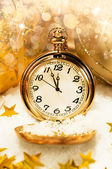 Pocket watch showing five minutes to midnight. — Stock Photo