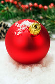Red Christmas ball in the snow — Stock Photo